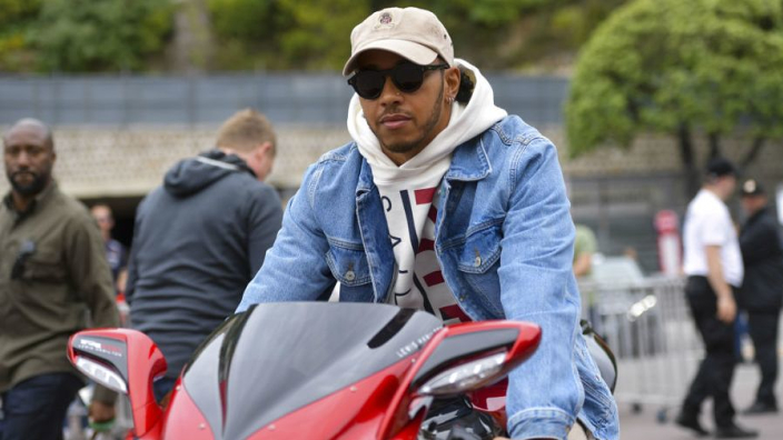 PHOTOS: Hamilton arrives at Monaco GP on two wheels in style!