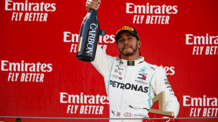 Hamilton dedicates Spanish win to fan with cancer