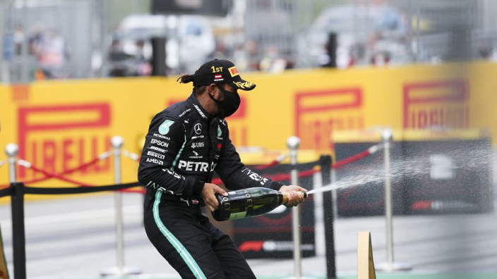 "Hamilton sees himself continuing in F1 ""for at least another three years"""
