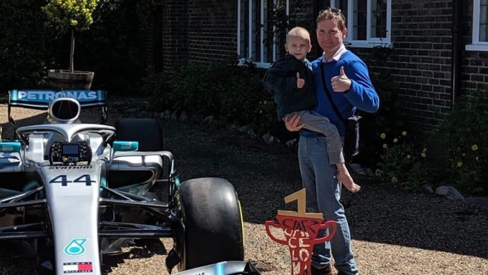 Mercedes send Hamilton's trophy and car to house of young cancer patient