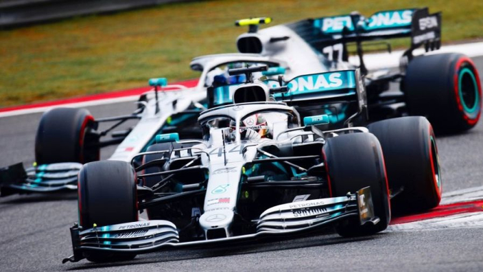 Hamilton takes championship lead after Ferrari farce in China