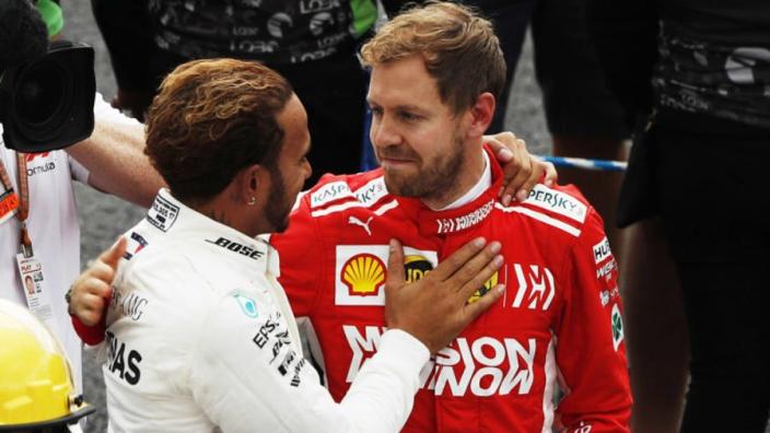 VIDEO: Vettel visits Mercedes garage after Hamilton title win