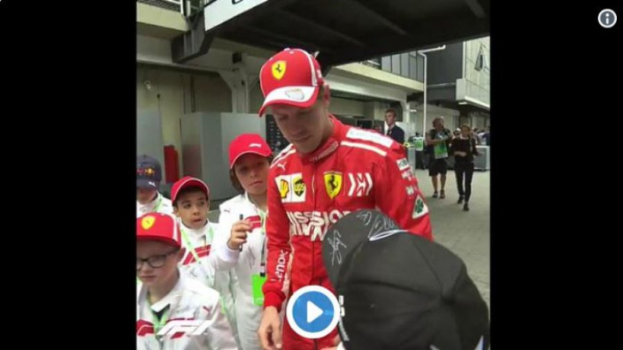 VIDEO: Vettel not a fan of grid kid's Mercedes cap