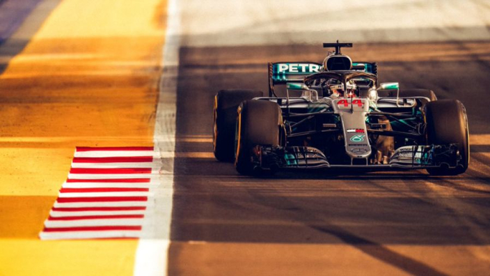 Hamilton lights up Singapore to take pole