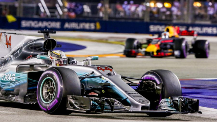 Hamilton opens up huge title lead in Singapore after Ferrari wreck Vettel's race