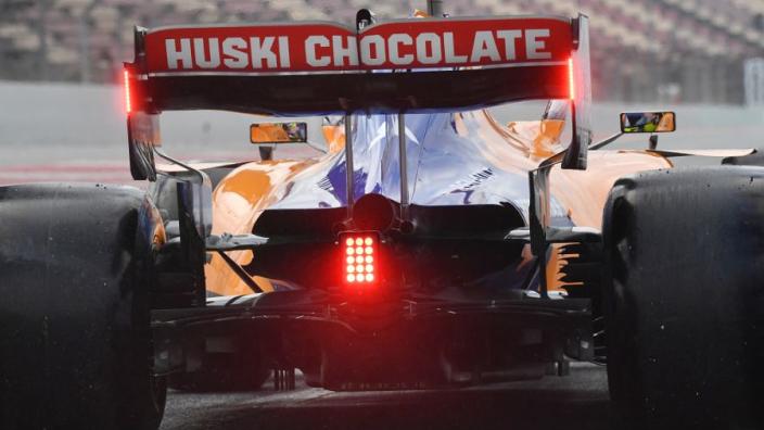 Welke functies heeft het achterlicht op een Formule 1-auto?